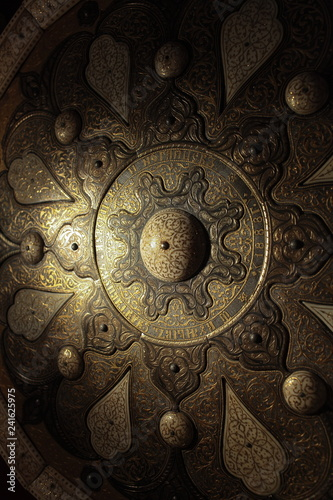 Photo gold patterns on old armor, Ancient  shield close to