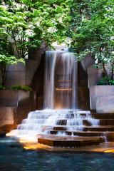 Fototapeta Wodospad cascading waterfall in a park