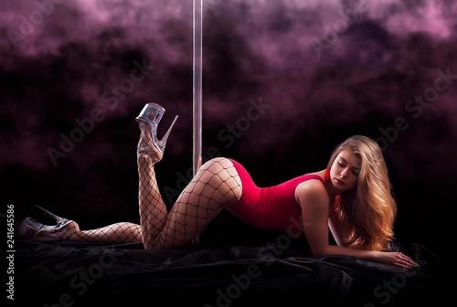 Fotografie, Obraz  Poledancer on black background