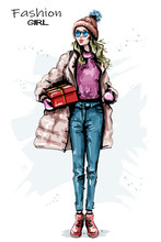 Hand Drawn Beautiful Young Woman With Gift Box. Stylish Girl Winter Outfit. Fashion Woman Look. Sketch.