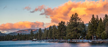 Beautiful Sunset Views Of The Shoreline Of South Lake Tahoe, Houses Visible Among Pine Trees