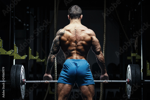 Muscular man bodybuilder training in gym and posing Canvas Print