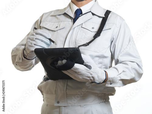 Fototapeta  タブレット端末と作業員