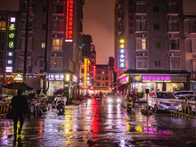 Zhangjiajie/China - 13 October 2018:Beautiful City Of Zhangjiajie City In The Night With The Rain In Holiday Time.sightseeing Building In The Night Time Of Zhangjiajie City China