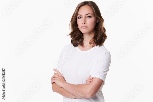 Fotografie, Obraz  Seriously beautiful brunette in white t-shirt, portrait