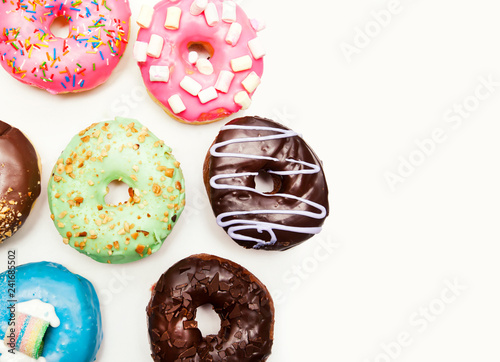 Canvas-taulu Lots of different donuts isolated on the white background