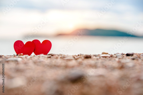 romantic symbol of two hearts on the beach Fototapeta