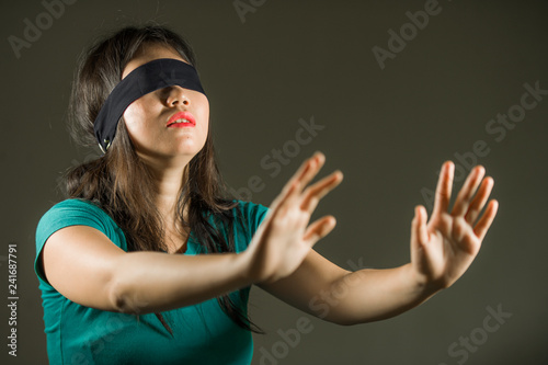 Fotografie, Obraz  young scared and blindfolded Asian Chinese teenager girl lost and confused playi