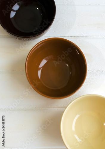 Foto op Plexiglas Set of bowls. Written breakfas, lunch, dinner on ceramic bowls. Menu concept