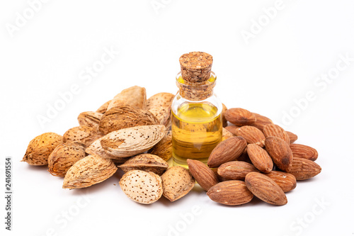 Foto op Plexiglas Kruiderij Almond oil on the white background. Organic herbal oil.