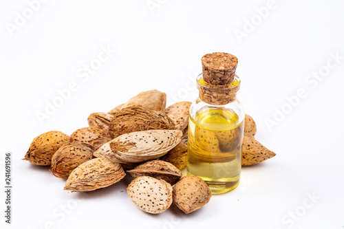 Almond oil on the white background. Organic herbal oil.