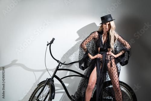 Portrait of a girl in a transparent robe near the bike Fototapeta