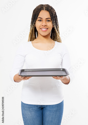 Young attractive woman holding empty pizza tray isolated on white background. Copy space and mock up. Blank template background.