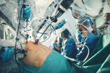 Surgical Room In Hospital With Robotic Technology Equipment, Machine Arm Surgeon In Futuristic Operation Room. Minimal Invasive Surgical Medical Robot,  Urology Surgery With Robotic Assisted Surgeon