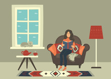 Woman In Cozy Armchair Reading...