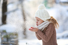 Funny Caucasian Girl Long Hair Blowing On Snow