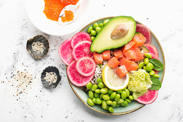 Fresh seafood recipe. Salmon and Caviar poke bowl with fresh prawn, brown rice, cucumber, pickled sweet onion, radish, soy beans edamame portioned with black and white sesame. Food concept poke bowl