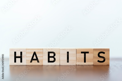 Fotografia, Obraz Habits word written on wooden cubes