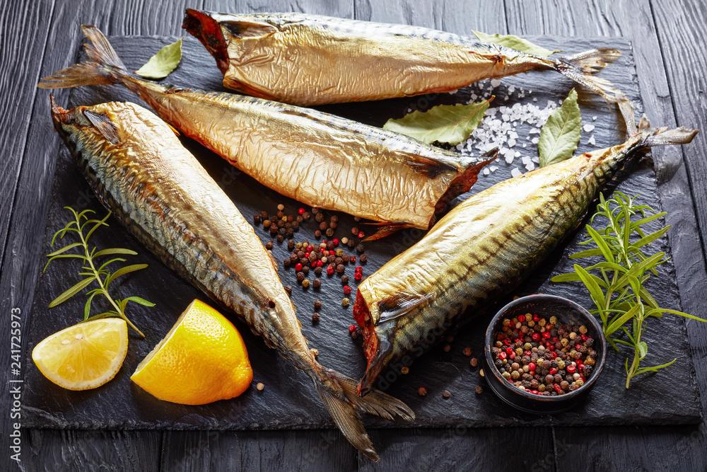 Fototapeta Hot smoked mackerel on a black tray