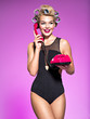 canvas print picture - Young cheerful woman calling by retro phone.