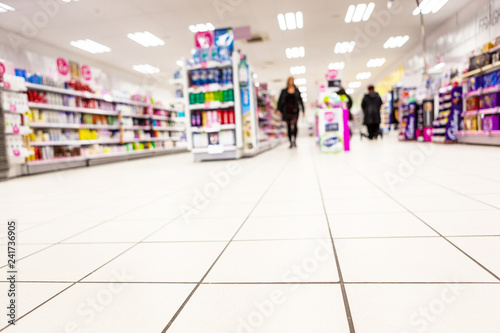 Fotobehang Apotheek Abstract background blurred photograph of an aisle with shelves in bright modern drugstore at supermarket shopping center
