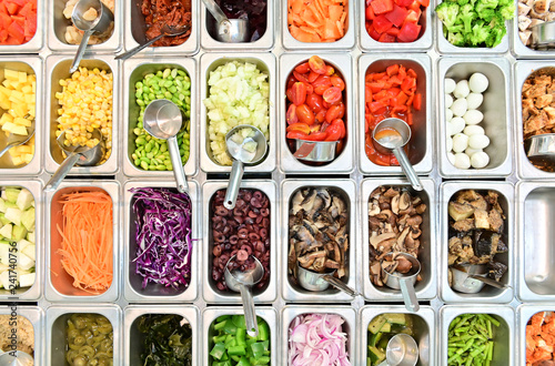 Top view of salad bar with assortment of ingredients