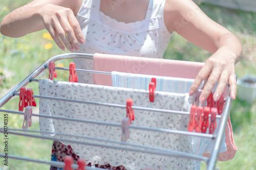 Fotografie, Obraz  Woman Hanging Laundry