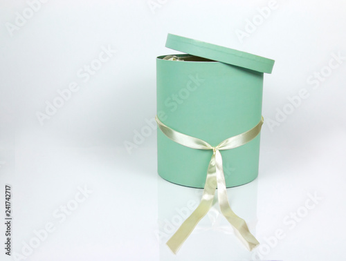 0e139e4d256138 Decorative Round Teal Hat Box with Cream colored ribbon isolated on plain white  background