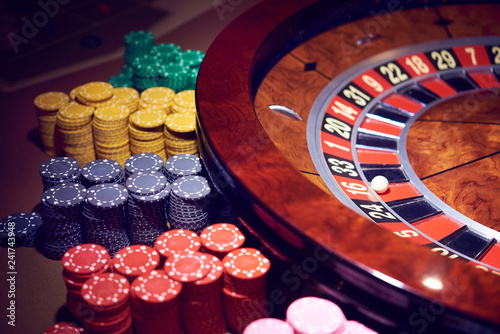 фотография  Gambling roulette with chips in the casino