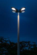 Light Pole Lit Against Dark Bl...