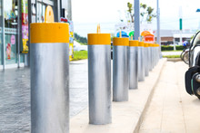 Stainless Steel Bollard Barriers In Front A Shop Prevent People For Security.