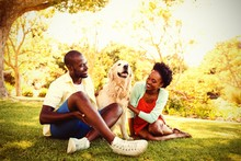 Couple Posing With A Dog