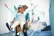 Happy couple enjoying while riding bicycle