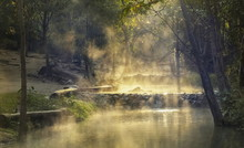Tha Pai Hot Spring Or Pong Nam Ron Tha Pai, View Morning Of Hot Water Flowing With Streaming Around With Forest And Sun Light Background, Pai District, Mae Hong Son, Northern Of Thailand.