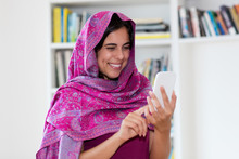 Indian Woman With Scarf Sending Message With Cellphone