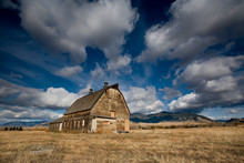 Old Barn Against Backdrop Of B...