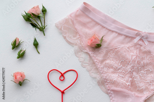 Photo  Pink lingerie panty. Fashion cloth, lingerie. Concept of love.