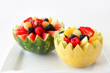 Fancy Cut Melon And Watermelon With Assorted Fruit Inside On A White Background