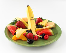 Banana With Funny Face On Plate Of Fruit