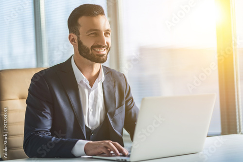 The man working with a laptop on the table