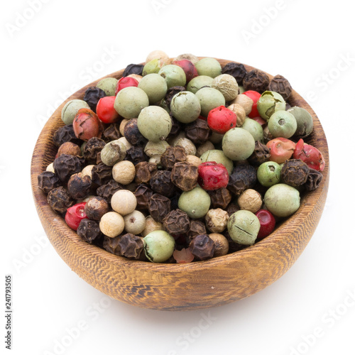 Foto op Canvas Kruiderij Pepper mix seed on spoon on white background.