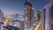 Aerial view of Dubai Marina after sunset from a vantage point day to night timelapse.