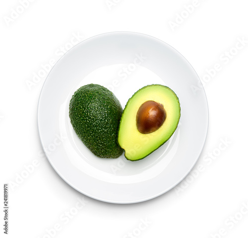Leinwand Poster Avocado on plate over white background