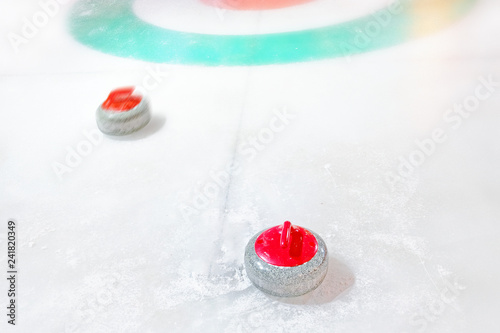 Fotografia  white winter sport curling game outdoor activity granite red stones on natural i