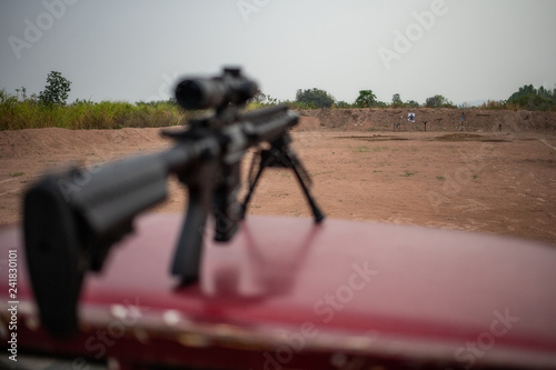 Canvas Print assault rifle on shooting field