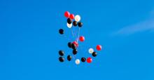 Red White Black Balloons Floating Away