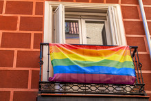 Homosexual Rainbow Flag On The Balcony. Street View. House With