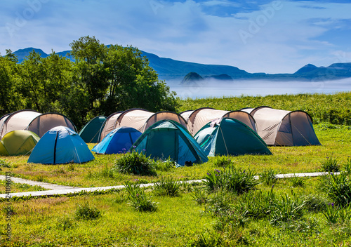 Fotografie, Obraz  Tourists camped in the woods on the shore of the lake on the hillside