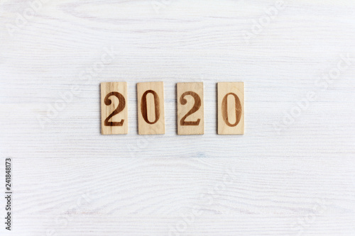 Fotografia  2020 number on wooden plates lying on a light wooden surface top view