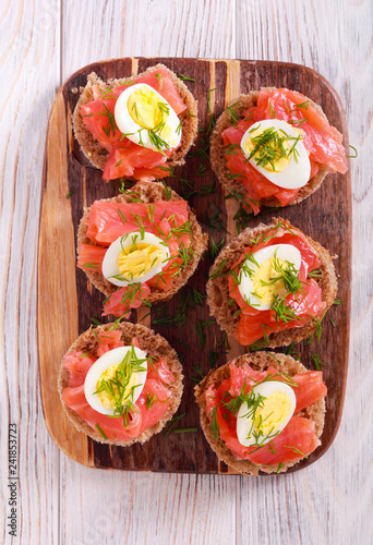 Snacks with salmon, quill egg and dill